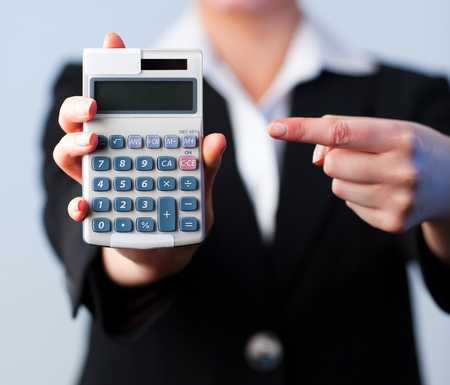 Business woman with a calculator photo
