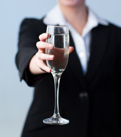Business woman Holding a Champagne Glass photo