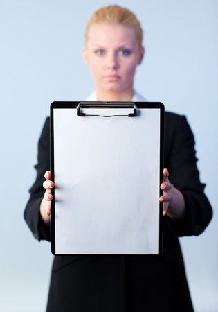 businesswoman holding a clipboard photo