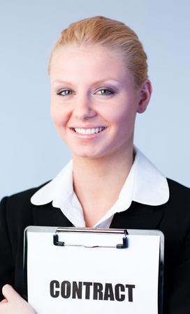 Woman holding a contract on a clipboard Stock Photo - 10258639