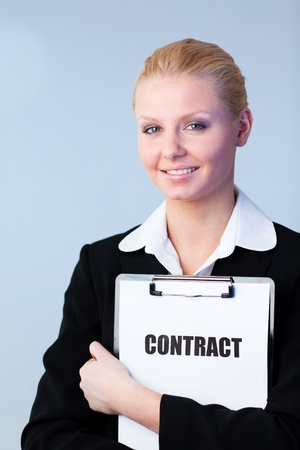 Woman holding a contract on a clipboard Stock Photo - 10257230
