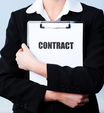 Woman holding a contract on a clipboard photo