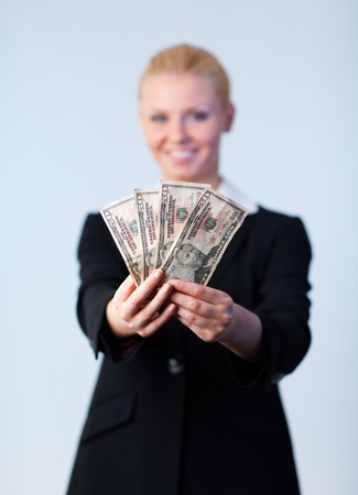 Business woman holding up dollars  photo