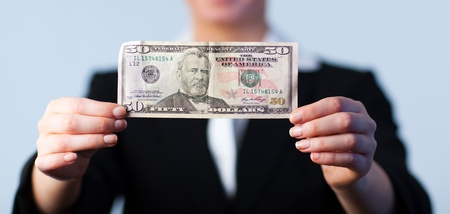 Business woman holding up dollars  Stock Photo - 10232525
