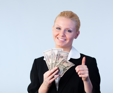 woman holding dollars with thumb up photo