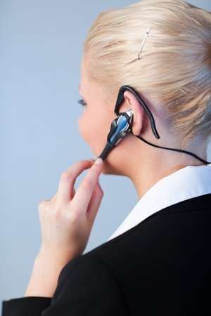 Business woman using a headset photo