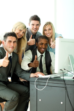 International business team working in office with thumbs up photo
