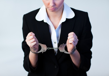 Business Woman in Handcuffs Stock Photo - 10256300