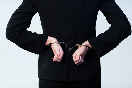 woman prison: Business person handcuffed