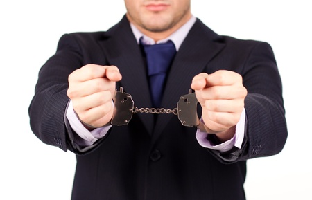 Businessman tied up in hand cuffs photo