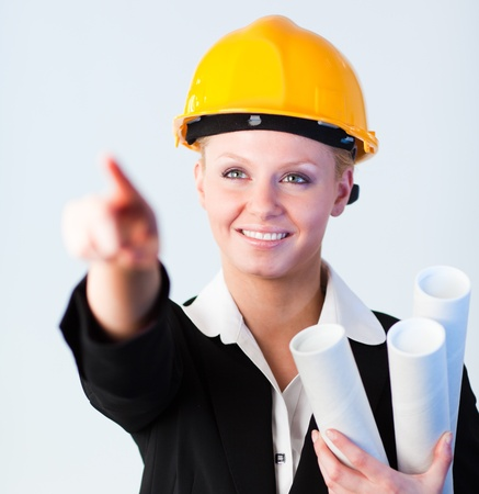 Female Construction worker pointing photo