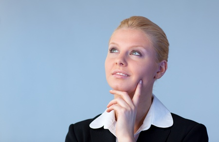 Happy Businesswoman looking upwards photo