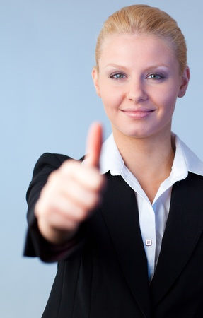 Businesswoman with thumbs up photo