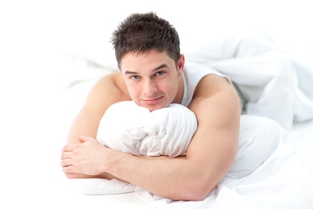 Man lying on bed awake Stock Photo - 10249307
