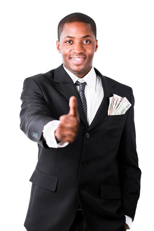 Portrait of young successful businessman showing thumb up photo