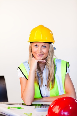 hard working woman: Young female with hard hat  Stock Photo