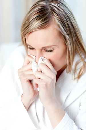 Sick woman blowing Stock Photo - 10248764