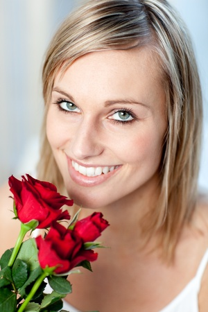Portrait of a smiling woman holding roses  Stock Photo - 10250045
