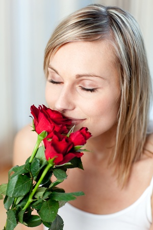 Beautiful woman smelling roses  photo