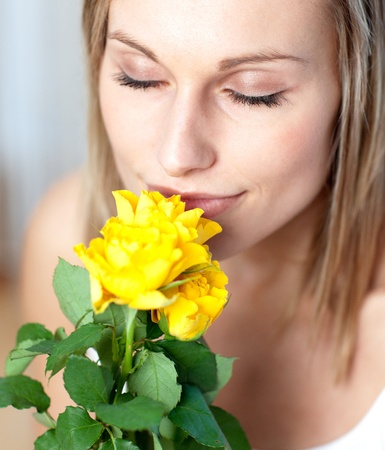 Attractive woman smelling roses  photo