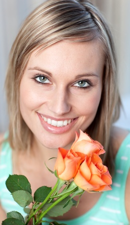 Portrait of a delighted woman holding roses Stock Photo - 10250248