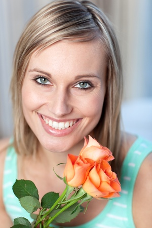 Portrait of a radiant woman holding roses photo