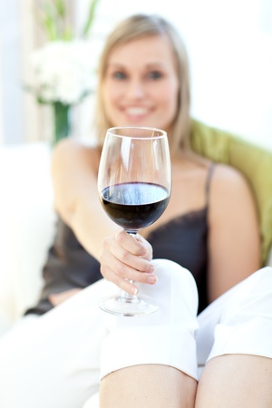 Radiant woman drinking red wine  photo