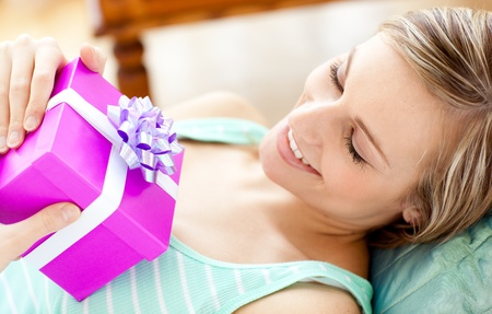 Happy woman holding a present  Stock Photo - 10248844