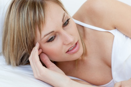 Unhappy woman lyingg on her bed Stock Photo - 10250373