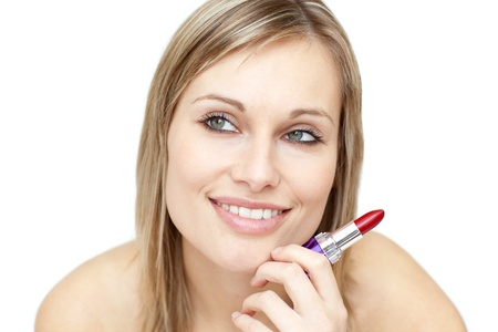 Attractive woman holding red lipstick Stock Photo - 10247994
