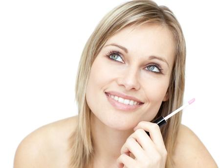 Portrait of a beautiful woman holding a lipstick photo