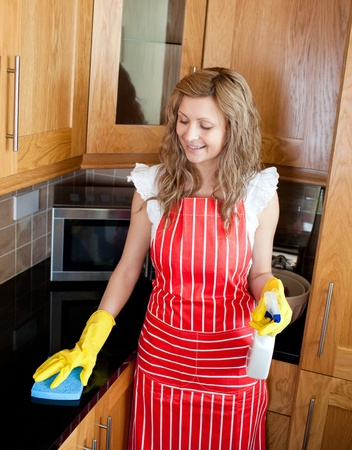 Smiling woman doing housework photo