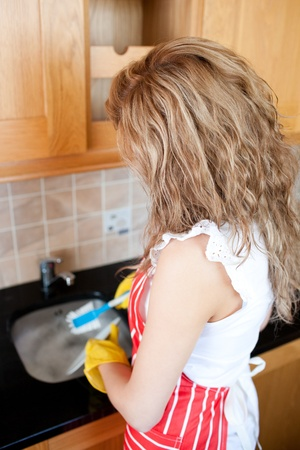 Caucasian woman doing the dishes  photo