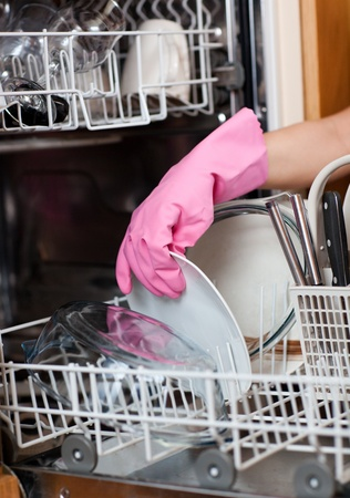 Close-up of a woman using a dishwasher photo