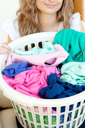 houseclean: Close-up of a young woman doing laundry