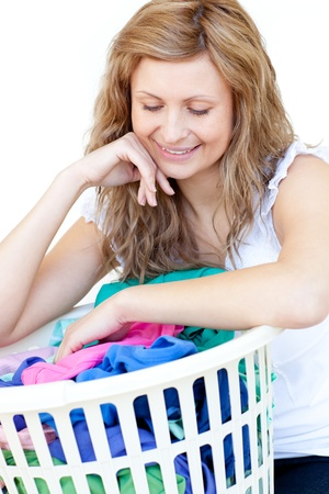 houseclean: Smiling woman doing laundry