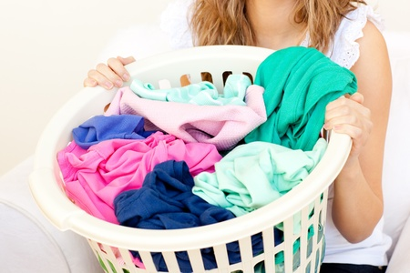 Close-up of a caucasian woman doing laundry photo