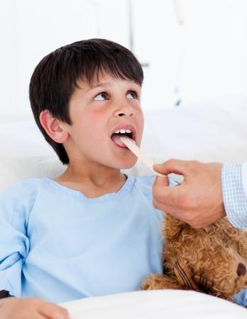 Cute little boy attending medical exam photo