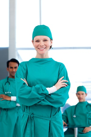 A group of doctors wearing surgical gown photo