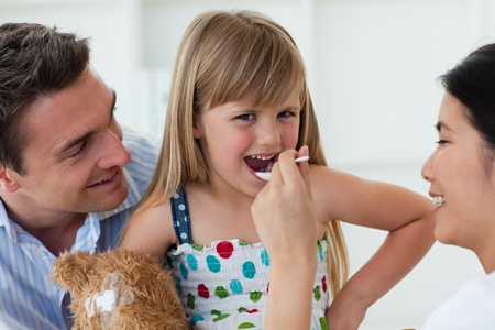 Confident doctor giving medecine to a little girl  Stock Photo - 10250237