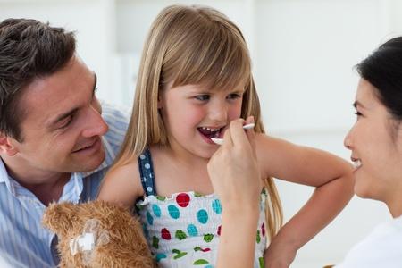 medecine: Smiling doctor giving medecine to a child Stock Photo