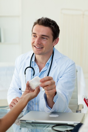 doctor giving pills: A doctor giving pills to his patient