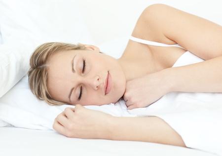 Attractive woman sleeping on a bed photo