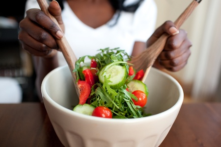 Ethnic woman preparing a salad photo