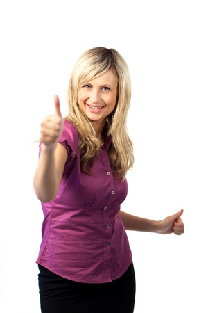 Young woman with her thumb up to camera Stock Photo - 10247309