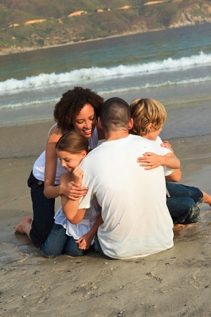 Smiling family on a beach photo