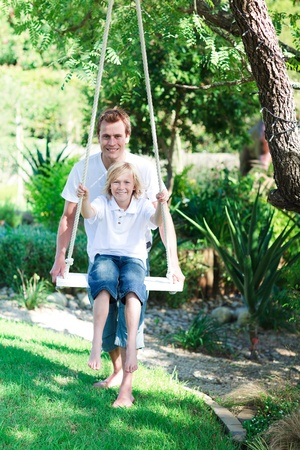 Father and son swinging Stock Photo - 10249045