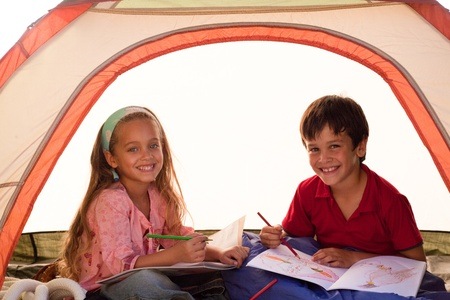Kids drawing in a tent photo