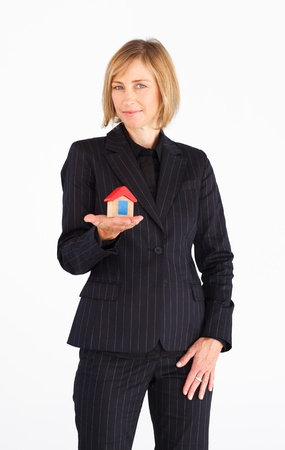 Businesswoman presenting model of house  photo