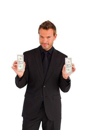 Confident businessman with money looking at the camera photo